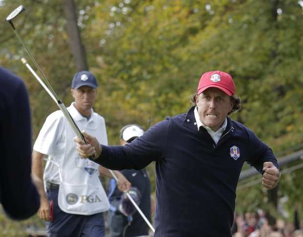 USA's Phil Mickelson reacts after making a putt to win the 13th hole during a foresomes match at the Ryder Cup Friday, Sept. 28, 2012, at the Medinah Country Club in Medinah, Ill.