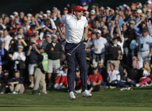 USA's Keegan Bradley reacts after nearly making a long eagle putt on the 15th hole during a four-ball match at the Ryder Cup PGA golf tournament Friday, Sept. 28, 2012, at the Medinah Country Club in Medinah, Ill.