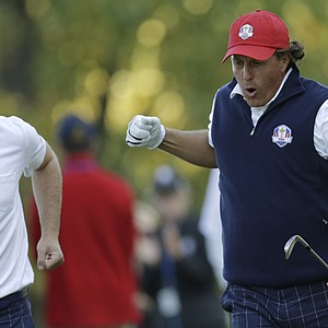 USA's Phil Mickelson, right, and Keegan Bradley react to Mickelson's tee shot on the 17th hole during a four-ball match at the Ryder Cup PGA golf tournament Friday, Sept. 28, 2012, at the Medinah Country Club in Medinah, Ill.