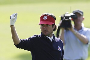 USA's Bubba Watson reacts to a shot on the 12th hole during a four-ball match at the Ryder Cup PGA golf tournament Friday, Sept. 28, 2012, at the Medinah Country Club in Medinah, Ill.