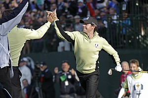 Europe's Rory McIlroy is congratulated by teammate Graeme McDowell after chipping in to win the fourth hole during a foursomes match at the Ryder Cup Friday, Sept. 28, 2012, at the Medinah Country Club in Medinah, Ill.