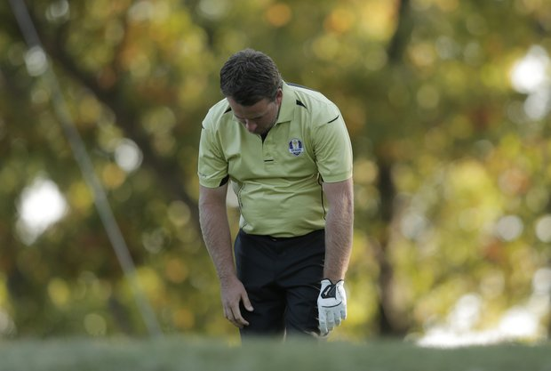 Europe's Graeme McDowell reacts after his tee shot on the 17th hole during a four-ball match at the Ryder Cup PGA golf tournament Friday, Sept. 28, 2012, at the Medinah Country Club in Medinah, Ill.