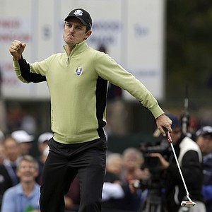 Europe's Justin Rose reacts after making a putt on the fourth hole during a foursomes match at the Ryder Cup Friday, Sept. 28, 2012, at the Medinah Country Club in Medinah, Ill.