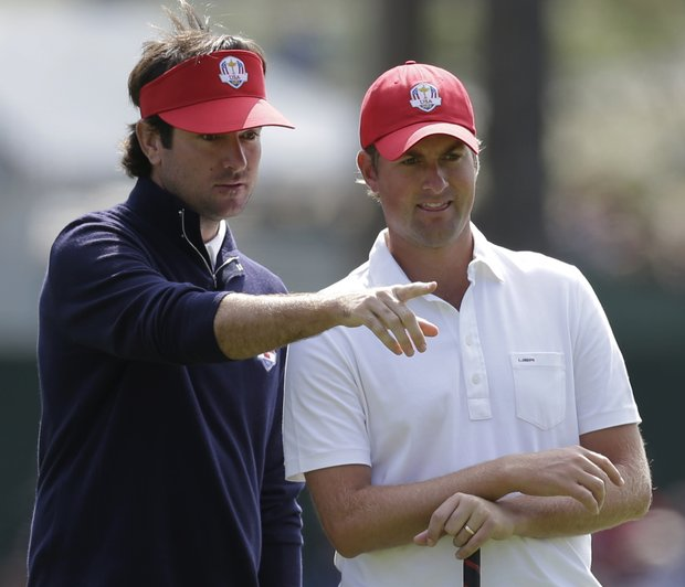USA's Bubba Watson and USA's Webb Simpson look over the fourth hole during a four-ball match at the Ryder Cup PGA golf tournament Friday, Sept. 28, 2012, at the Medinah Country Club in Medinah, Ill.
