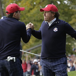 USA's Keegan Bradley congratulates Phil Mickelson after Mickelson made a putt to win the 13th hole during a foursomes match at the Ryder Cup Friday, Sept. 28, 2012, at the Medinah Country Club in Medinah, Ill.