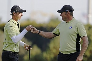 Europe's Nicolas Colsaerts is congratulated by Europe's Lee Westwood after making an eagle putt on the 10th hole during a four-ball match at the Ryder Cup PGA golf tournament Friday, Sept. 28, 2012, at the Medinah Country Club in Medinah, Ill.