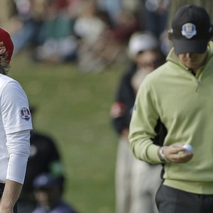 USA's Brandt Snedeker reacts in front of Europe's Rory McIlroy after missing a putt on the 12th hole during a foursomes match at the Ryder Cup Friday, Sept. 28, 2012, at the Medinah Country Club in Medinah, Ill.