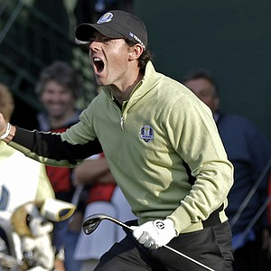 Europe's Rory McIlroy reacts after chipping in on the fourth hole during a foursomes match at the Ryder Cup Friday, Sept. 28, 2012, at the Medinah Country Club in Medinah, Ill.