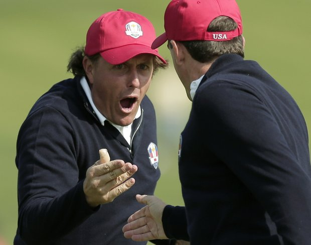 USA's Phil Mickelson, left, and Keegan Bradley celebrate after winning their foursomes match on the 15th hole at the Ryder Cup Friday, Sept. 28, 2012, at the Medinah Country Club in Medinah, Ill.