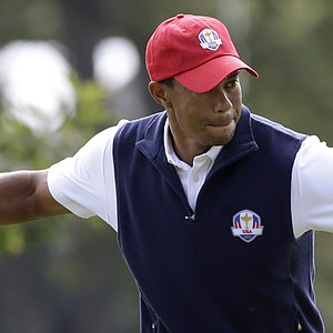 USA's Tiger Woods reacts after making a putt on the first hole during a four-ball match at the Ryder Cup Friday, Sept. 28, 2012, at the Medinah Country Club in Medinah, Ill.