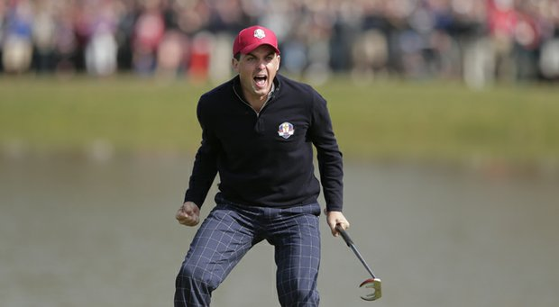 USA's Keegan Bradley celebrates after winning their foursomes match on the 15th hole at the Ryder Cup Friday, Sept. 28, 2012, at the Medinah Country Club in Medinah, Ill.