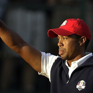USA's Tiger Woods reacts after making a birdie on the 15th hole during a four-ball match at the Ryder Cup PGA golf tournament Friday, Sept. 28, 2012, at the Medinah Country Club in Medinah, Ill.