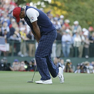 USA's Tiger Woods reacts after missing a birdie putt on the 18th hole to lose a four-ball match at the Ryder Cup PGA golf tournament Friday, Sept. 28, 2012, at the Medinah Country Club in Medinah, Ill.