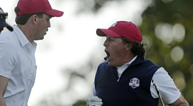 USA's Phil Mickelson reacts to his tee shot on the 17th hole during a four-ball match at the Ryder Cup PGA golf tournament Friday, Sept. 28, 2012, at the Medinah Country Club in Medinah, Ill.