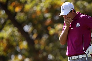Nicolas Colsaerts of Europe reacts to hitting a ball in the water on the 17th hole.