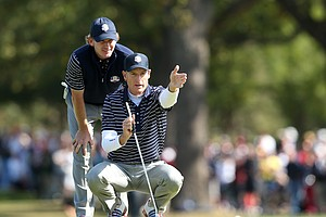Jim Furyk and Brandt Snedeker of the USA line up a putt on the 15th green during Day 2 at the Ryder Cup.