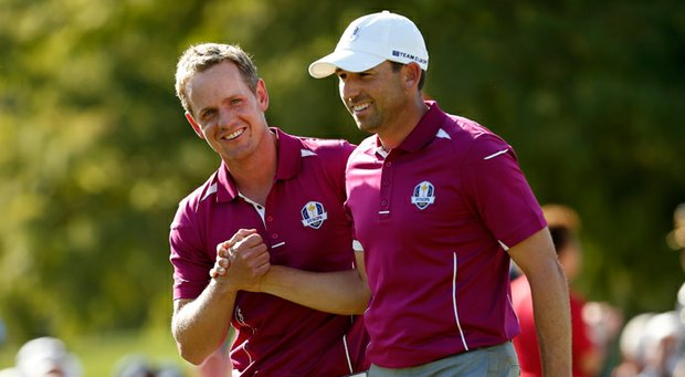 Luke Donald, left, and Sergio Garcia of Europe win the ninth hole during the afternoon four-ball matches Saturday at the 39th Ryder Cup at Medinah Country Club.