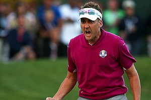 Ian Poulter of Europe celebrates after making birdie on the 16th green during an afternoon four-ball matches at the Ryder Cup at Medinah Country Club.