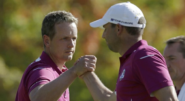 Europe's Sergio Garcia, right, congratulates Luke Donald after winning the eighth hole during a four-ball match at the Ryder Cup PGA golf tournament Saturday, Sept. 29, 2012, at the Medinah Country Club in Medinah, Ill.