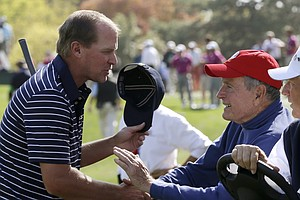 USA's Steve Stricker shakes hands with former President George H. W. Bush during a four-ball match at the Ryder Cup PGA golf tournament Saturday, Sept. 29, 2012, at the Medinah Country Club in Medinah, Ill.