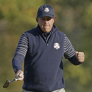 USA's Phil Mickelson reacts as he makes a putt on the fifth hole during a foursomes match at the Ryder Cup PGA golf tournament Saturday, Sept. 29, 2012, at the Medinah Country Club in Medinah, Ill.