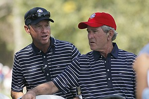 USA's captain Davis Love III talks to Former President George W. Bush during a four-ball match at the Ryder Cup PGA golf tournament Saturday, Sept. 29, 2012, at the Medinah Country Club in Medinah, Ill.