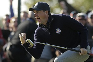 USA's Keegan Bradley reacts after making a putt on the ninth hole during a foursomes match at the Ryder Cup Saturday, Sept. 29, 2012, at the Medinah Country Club in Medinah, Ill.