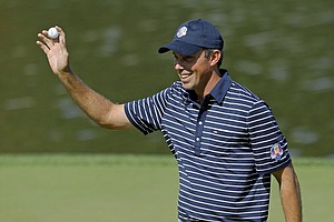 USA's Matt Kuchar reacts after making a birdie putt on the second hole during a four-ball match at the Ryder Cup PGA golf tournament Saturday, Sept. 29, 2012, at the Medinah Country Club in Medinah, Ill.