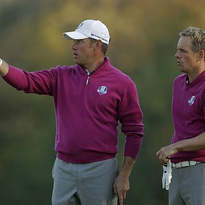 Europe's Lee Westwood, left, and Luke Donald look over a shot on the fifth hole during a foursomes match at the Ryder Cup PGA golf tournament Saturday, Sept. 29, 2012, at the Medinah Country Club in Medinah, Ill.