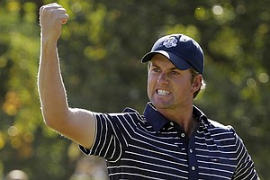 USA's Webb Simpson reacts after making a putt on the 11th hole during a four-ball match at the Ryder Cup Saturday, Sept. 29, 2012, at the Medinah Country Club in Medinah, Ill.
