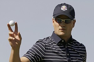 USA's Zach Johnson reacts after making a birdie putt on the first hole during a four-ball match at the Ryder Cup PGA golf tournament Saturday, Sept. 29, 2012, at the Medinah Country Club in Medinah, Ill.