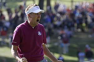 Europe's Ian Poulter reacts after making a birdie putt to win the 12th hole during a foursomes match at the Ryder Cup PGA golf tournament Saturday, Sept. 29, 2012, at the Medinah Country Club in Medinah, Ill.