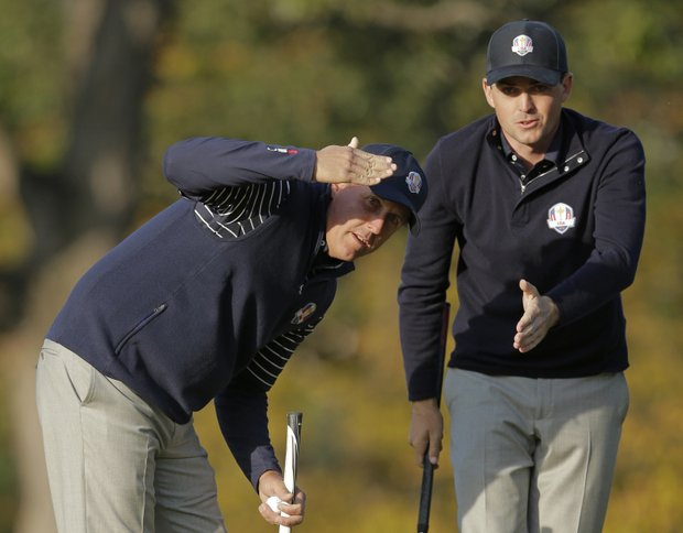 USA's Phil Mickelson, left, and Keegan Bradley look over a putt on the fourth hole during a foursomes match at the Ryder Cup PGA golf tournament Saturday, Sept. 29, 2012, at the Medinah Country Club in Medinah, Ill.