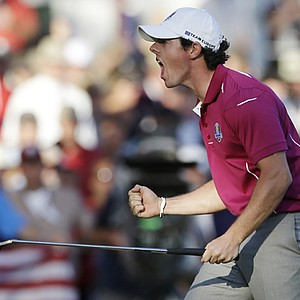 Europe's Rory McIlroy reacts after making a birdie putt on the 13th hole during a four-ball match at the Ryder Cup Saturday, Sept. 29, 2012, at the Medinah Country Club in Medinah, Ill.
