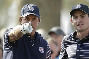 USA's Phil Mickelson talks to Keegan Bradley on the 12th tee during a foursomes match at the Ryder Cup PGA golf tournament Saturday, Sept. 29, 2012, at the Medinah Country Club in Medinah, Ill.