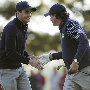 USA's Phil Mickelson, right, and Keegan Bradley react on the seventh hole during a foursomes match at the Ryder Cup PGA golf tournament Saturday, Sept. 29, 2012, at the Medinah Country Club in Medinah, Ill.