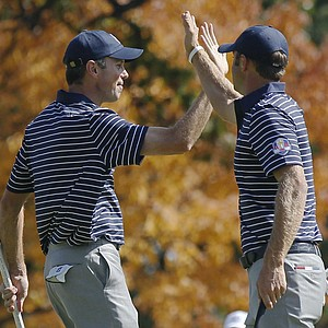 USA's Matt Kuchar, left, is congratulated by Dustin Johnson after making a birdie putt on the fourth hole during a four-ball match at the Ryder Cup PGA golf tournament Saturday, Sept. 29, 2012, at the Medinah Country Club in Medinah, Ill.