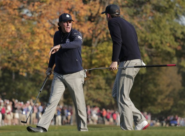 USA's Phil Mickelson, left, is congratulated by Keegan Bradley after making a putt on the fifth hole during a foursomes match at the Ryder Cup PGA golf tournament Saturday, Sept. 29, 2012, at the Medinah Country Club in Medinah, Ill.