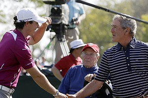 Europe's Rory McIlroy shakes hands with Former President George W. Bush during a four-ball match at the Ryder Cup PGA golf tournament Saturday, Sept. 29, 2012, at the Medinah Country Club in Medinah, Ill.