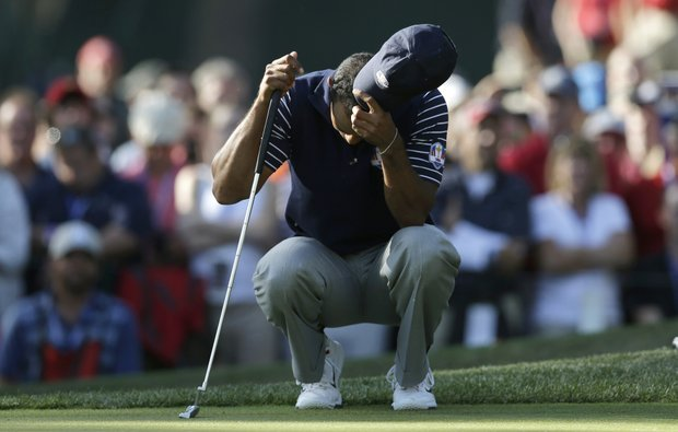 USA's Tiger Woods pauses on the 11th green during a four-ball match at the Ryder Cup PGA golf tournament Saturday, Sept. 29, 2012, at the Medinah Country Club in Medinah, Ill.