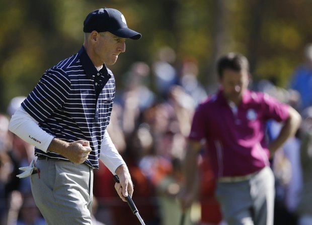 USA's Jim Furyk reacts after making a birdie putt on the 11th hole during a foursomes match at the Ryder Cup PGA golf tournament Saturday, Sept. 29, 2012, at the Medinah Country Club in Medinah, Ill.