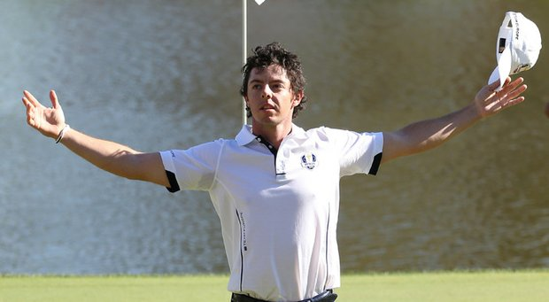 Rory McIlroy of Europe waves to the gallery on the 17th green after winning his match against Keegan Bradley.