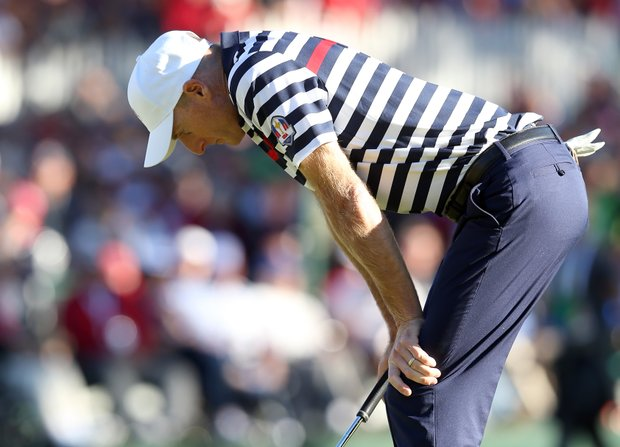 Jim Furyk of the USA reacts to a missed par putt on the 18th green that cost him a 1-down loss to Sergio Garcia.