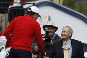USA's Phil Mickelson, left, shakes hands with Jack Nicklaus on the first hole before a singles match at the Ryder Cup PGA golf tournament Sunday, Sept. 30, 2012, at the Medinah Country Club in Medinah, Ill.