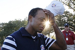 USA's Tiger Woods scratches his head as he walks off the course after the Ryder Cup PGA golf tournament Sunday, Sept. 30, 2012, at the Medinah Country Club in Medinah, Ill.