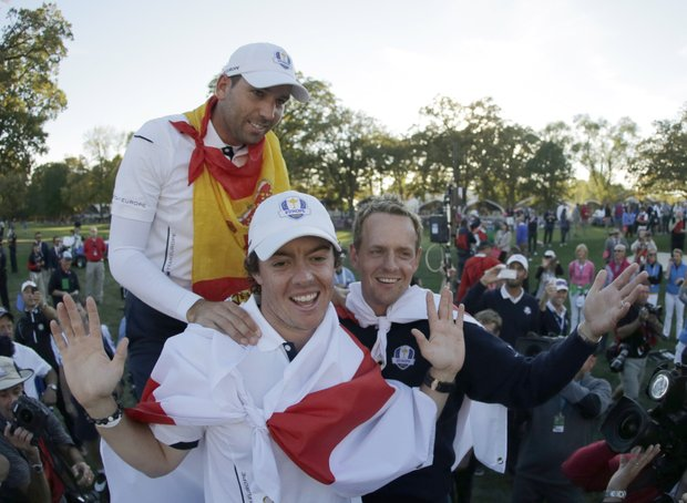 Europe's Sergio Garcia, Rory McIlroy and Luke Donald celebrate after winning the Ryder Cup PGA golf tournament Sunday, Sept. 30, 2012, at the Medinah Country Club in Medinah, Ill.
