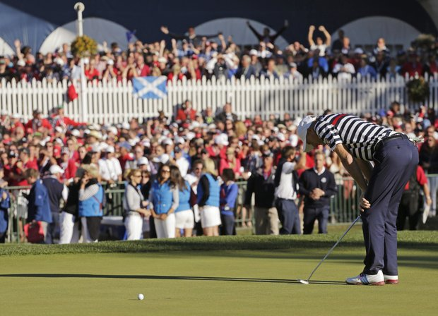 USA's Jim Furyk reacts after missing a putt on the 18th hole and losing to Europe's Sergio Garcia during a singles match at the Ryder Cup PGA golf tournament Sunday, Sept. 30, 2012, at the Medinah Country Club in Medinah, Ill.