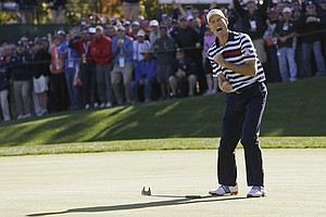 USA's Jim Furyk reacts after missing a putt on the 16th hole during a singles match at the Ryder Cup PGA golf tournament Sunday, Sept. 30, 2012, at the Medinah Country Club in Medinah, Ill.