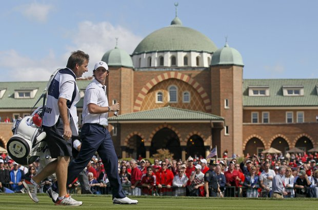 Europe's Rory McIlroy walks off the first tee during a singles match at the Ryder Cup PGA golf tournament Sunday, Sept. 30, 2012, at the Medinah Country Club in Medinah, Ill.