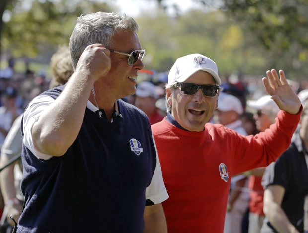 Co-captains Fred Couples and Darren Clarke chat on the 11th hole during a singles match at the Ryder Cup PGA golf tournament Sunday, Sept. 30, 2012, at the Medinah Country Club in Medinah, Ill.
